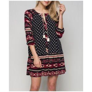 Dresses & Skirts - Swing Dress with Tassel Neckline